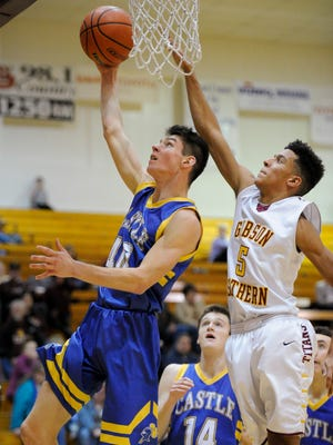 Castle's Triston Wilkinson (40) goes to the hoop past Gibson Southern's Alec Martin (5) during the Toyota Classic at Gibson Southern High School in Fort Branch, Monday, Dec. 19, 2016. Castle beat Gibson Southern 75-42.