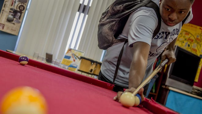 Roderick Rose Jr., 15, lines up a shot on a billiard table inside the Youth Center at Holloman Air Force Base on April 1. Rose is the president of the Holloman's Keystone Club – an organization dedicated on building character and leadership skills in teens. He was recently nominated to participate in a national-level competition that recognizes outstanding young adults.