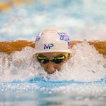 Michael Phelps swims the 100-meter butterfly during the preliminaries at the Mecklenburg County Aquatic Center.
