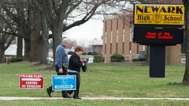 Voters walk to Newark High School to vote on a school referendum on March 23. Delaware can now direct back property taxes to school districts.