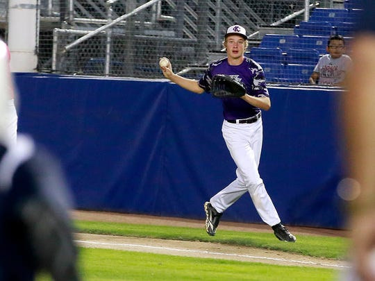 KC Storm's Brock Beckstead fields a ball at first base during a game against the Fuel on Tuesday at Ricketts Park.