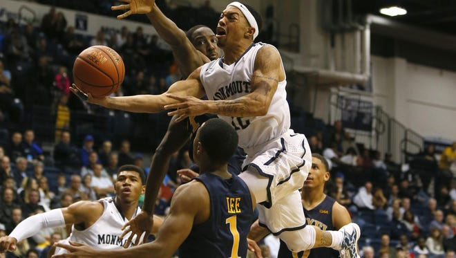 Monmouth Hawks guard Justin Robinson (12) drives to the basket over Drexel Dragons guard Kurk Lee (1) during the second half at Ocean First Bank Center,West Long Branch,NJ. Noah K. Murray-Correspondent/Asbury Park Press ASB 1112 Monmouth Basketball