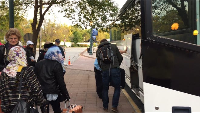 Passengers on Friday, October 2, 2015, board a bus instead of Indiana's Hoosier State train. The train was canceled eight times in 10 days due to mechanical issues, according to Iowa Pacific Holdings President Ed Ellis.