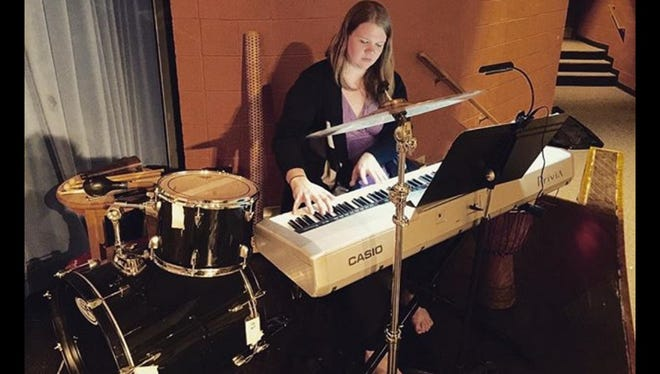 Eden Arts Cooperative leader Kim Gnagey, here on the keyboard, said her cooperative will bring the Plymouth PARC's vision of a bustling arts community further into focus.