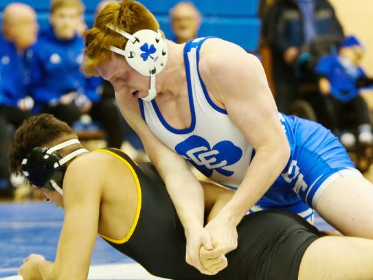Catholic Central's Rory Cox (top) stays in control