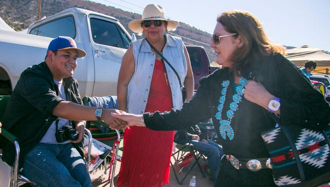 """U.S. Rep. Ann Kirkpatrick shakes hands with people along the parade route during the 68th Annual Navajo Nation Fair in Window Rock in 2014.  Kirkpatrick, whose U.S. Senate campaign trails incumbent U.S. Sen. John McCain, R-Ariz., in fundraising, """"thrives as an underdog,"""" her spokesman said."""