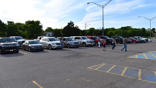 About 30 vehicles were in the Lone Grove High School parking lot Monday to hear the  announcement of Students of the Year. With social distancing guidelines in place, schools are trying creative ways to still recognize award recipients.