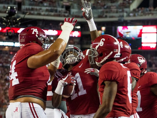 Alabama wide receiver Henry Ruggs III (11) celebrates
