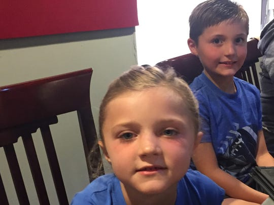 Six-year-old Mia and her big brother, 8-year-old Wyatt, step out to play food critic last weekend at Asahi Japanese Steakhouse.