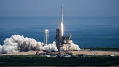 A SpaceX Falcon 9 rocket rocket lifts off from Pad