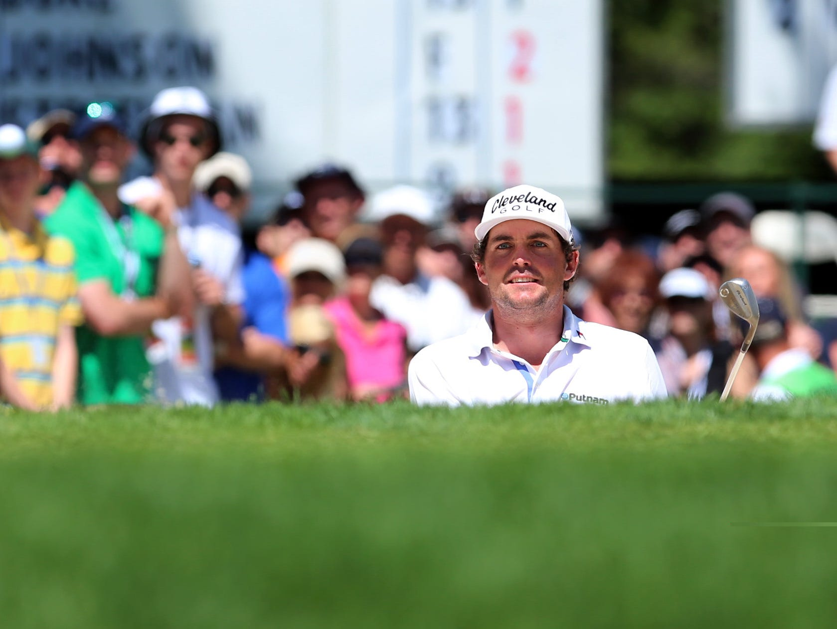 Keegan Bradley watches his bunker shot on the 8th green.