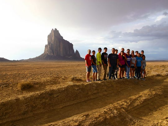 """This image from """"Mayors of Shiprock"""" shows members of the Northern Diné Youth Committee posing near the Shiprock pinnacle."""