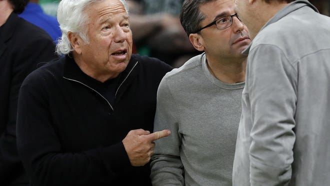 Lawyers for Patriots owner Robert Kraft, left, argue that installing cameras in legal massage parlors violates state law.