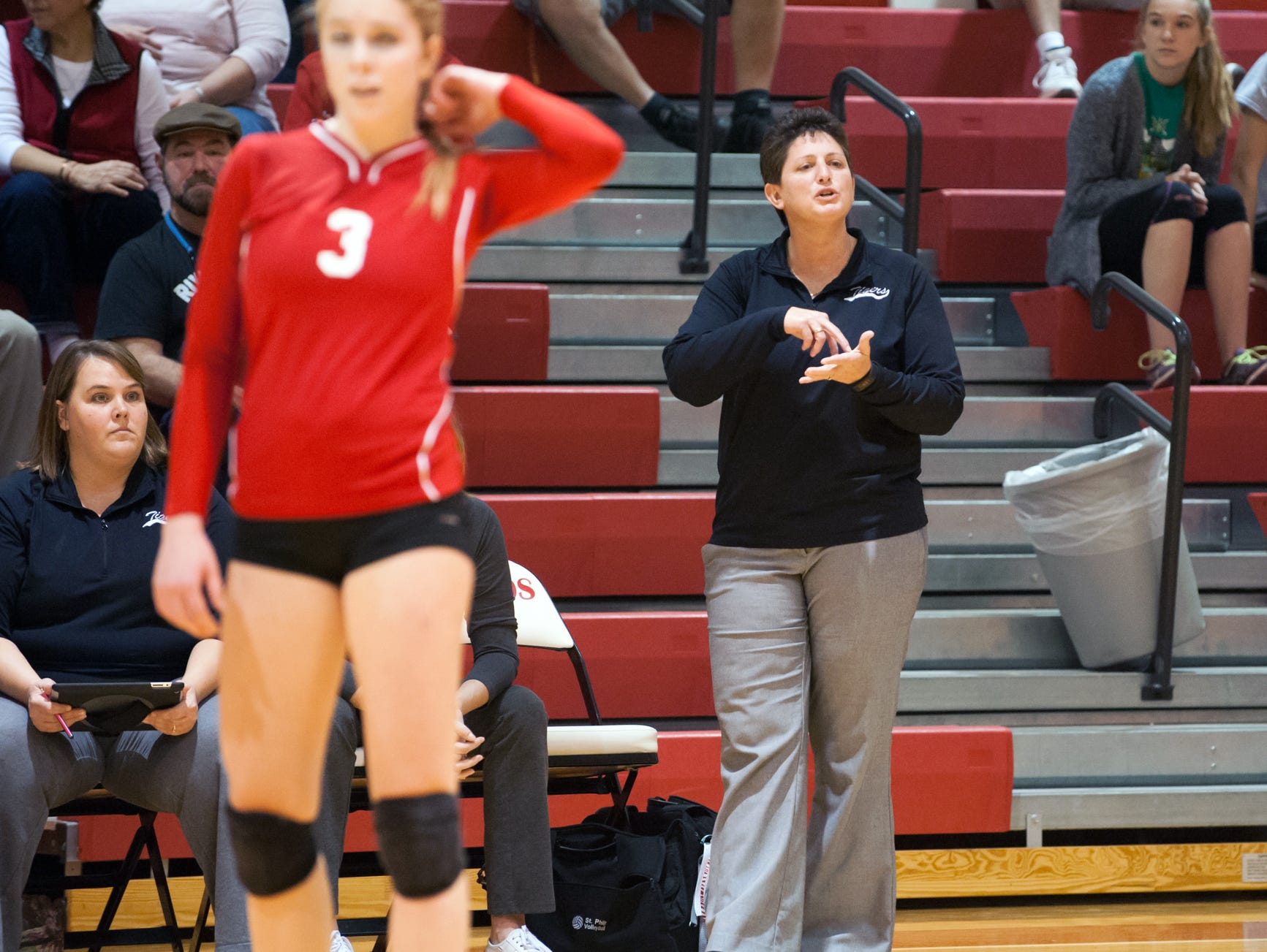 St. Philip head coach Vicky Groat talks with her players during game action in district play.