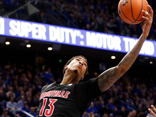 Louisville's Ray Spalding pulls down a rebound during the second half of an NCAA college basketball game against Kentucky, Friday, Dec. 29, 2017, in Lexington, Ky. Kentucky won 90-61. (AP Photo/James Crisp)