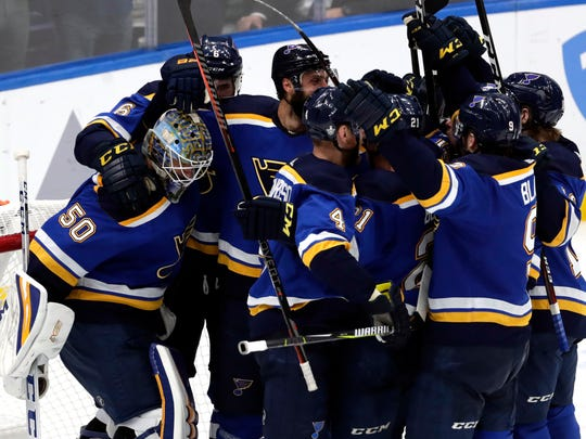 Members of the St. Louis Blues celebrate after defeating the San Jose Sharks 5-1 in Game 6 of the NHL hockey Stanley Cup Western Conference final series Tuesday, May 21, 2019, in St. Louis. (AP Photo/Tom Gannam)