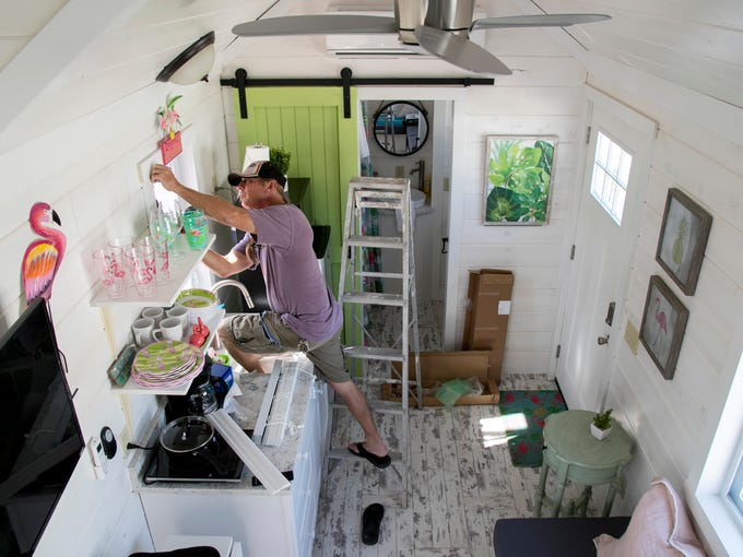 Dean Calhoun Installs Blinds In One Of The Tiny Houses