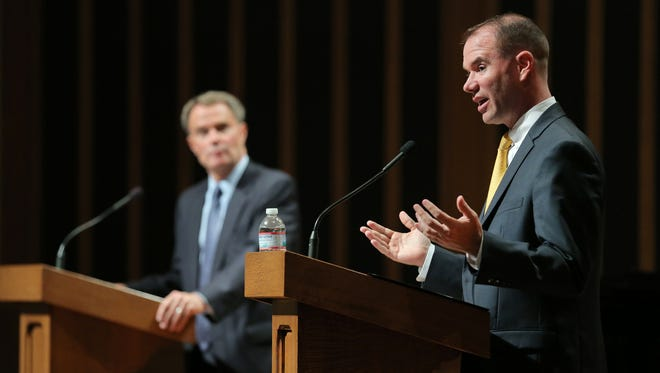 Mayoral candidate Chuck Brewer, right, answer questions from the community along with opponent Joe Hogsett during a mayoral forum held at the Indiana Landmark Center Grand Hall on Thursday, September 10, 2015.