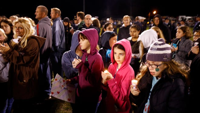 People gather on a field at the Toms River Intermediate School South in Beachwood Wednesday evening, November 16, 2016, to remember Jessica Rose Genovese, an 11-year-old daughter of Toms River Fire Co. 1 Chief John Genovese and his wife, Laura, who died suddenly Nov. 5 of meningitis encelphalitis after she was flown to Children's Hospital of Philadelphia for emergency treatment.