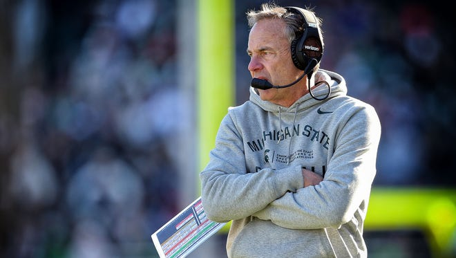 Michigan State coach Mark Dantonio stands on the sidelines during a game against the Rutgers Scarlet Knights on Nov. 12, 2016.