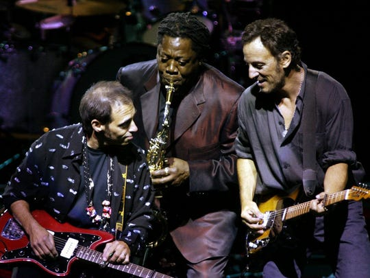 "Bruce Springsteen (right) is joined by Clarence ""Big Man"" Clemons (center) and guitarist Nils Lofgren during ""Prove It All Night"" in 2002."