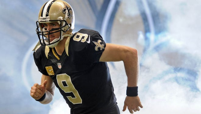 New Orleans Saints quarterback Drew Brees takes the field  during an NFL football game in New Orleans, Sunday, Nov. 10, 2013.