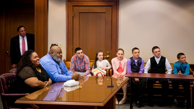 Christina and Christopher Sanders sit before Judge Ralph Winkler in Hamilton County Probate Court to finalize the adoption of (from left to right) Coby, 16, Chloe, 9, Cayley, 12, Caleb, 13, Christan, 14, and Carson, 10 Thursday, April 27, 2017. The couple have five biological children and now have a total of eleven children.
