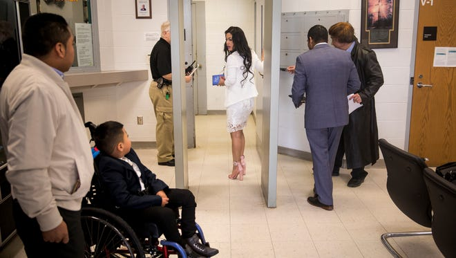 Sandra Mendoza enters the Morrow County Jail to marry Yancarlos Mendez with her pastor, Alfredo Ortiz, and her immigration attorney, Charleston Wang, as her son, Ricky, waits in the lobby. Ricky was not allowed to witness the wedding or see his stepfather.
