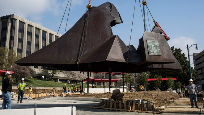 """Crews move a 20,000-pound steel sculpture, """"I Have Been to the Mountaintop,"""" on Friday, March 30, 2018, to Memphis' new Dr. Martin Luther King Reflection Park."""