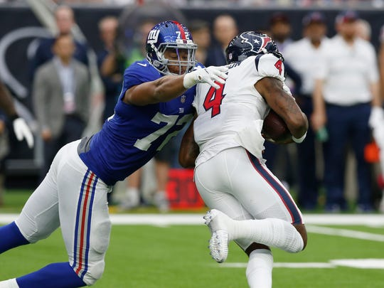 HOUSTON, TX - SEPTEMBER 23:  Deshaun Watson #4 of the Houston Texans is pressured by Kerry Wynn #72 of the New York Giants in the second quarter at NRG Stadium on September 23, 2018 in Houston, Texas.  (Photo by Tim Warner/Getty Images)