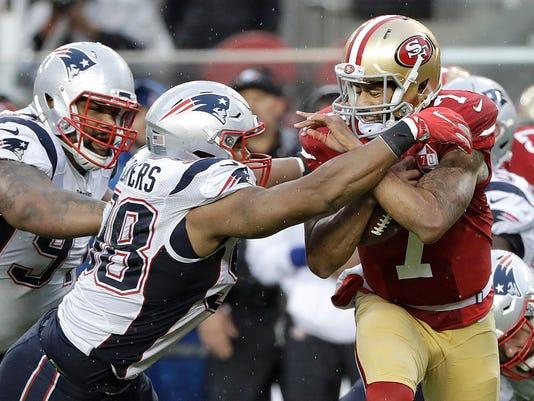 New England Patriots defensive end Trey Flowers (98) tackles San Francisco 49ers quarterback Colin Kaepernick (7) during the second half of an NFL football game in Santa Clara, Calif., Sunday, Nov. 20, 2016. (AP Photo/Marcio Jose Sanchez)