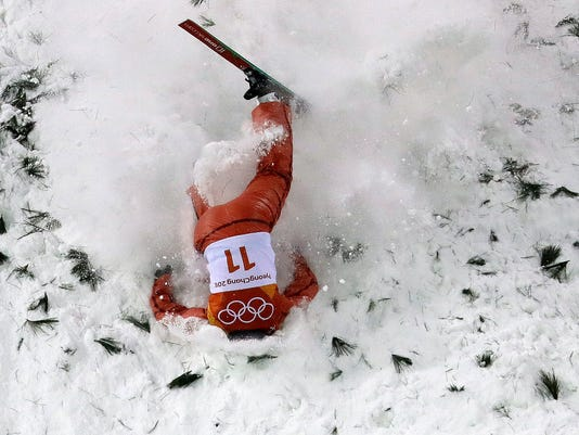 AllaTsuper, of Belarus, crashes during the women's freestyle aerial final at Phoenix Snow Park at the 2018 Winter Olympics in Pyeongchang, South Korea, Friday, Feb. 16, 2018. (AP Photo/Lee Jin-man, File)