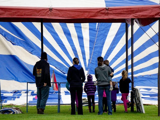 The Culpepper and Merriweather Circus invites visitors to watch workers set up the big tent.