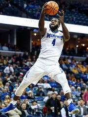 Memphis forward Raynere Thornton (right) drives for a layup against the Wichita State defense during second half action at the FedExForum in Memphis Tenn., Tuesday, February 6, 2018.