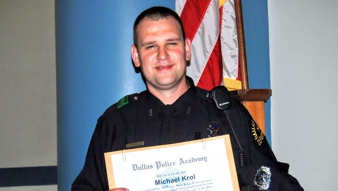 Dallas police officer Michael Krol, shown in this 2008 academy graduation picture, was one of five officers who died in the attack by a sniper during a protest rally. Krol previously worked for the Wayne County Sheriff's Department in Michigan. Family photo.