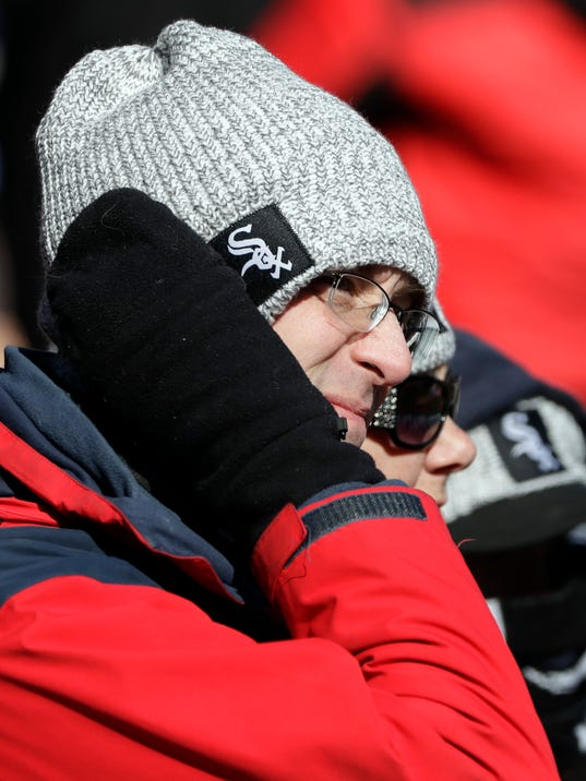 Baseball fans are bundled up as they watch a baseball game between the Detroit Tigers and the Chicago White Sox, Saturday, April 7, 2018, in Chicago. The Tigers won 6-1. (AP Photo/Nam Y. Huh)