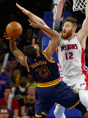 Aron Baynes, right, of the Detroit Pistons tries to block the shot of Tristan Thompson of the Cleveland Cavaliers on April 24, 2016, in Auburn Hills.