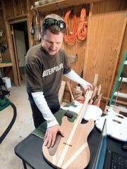 Milton resident Wesley Moore builds custom guitars