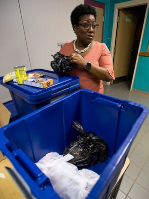 School counselor Karen Wilson checks on the backpack food program bags at Fitzpatrick Elementary School in Montgomery, Ala. on Friday November 17, 2017.