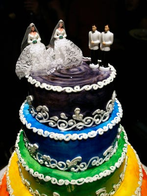 A rainbow-colored wedding cake