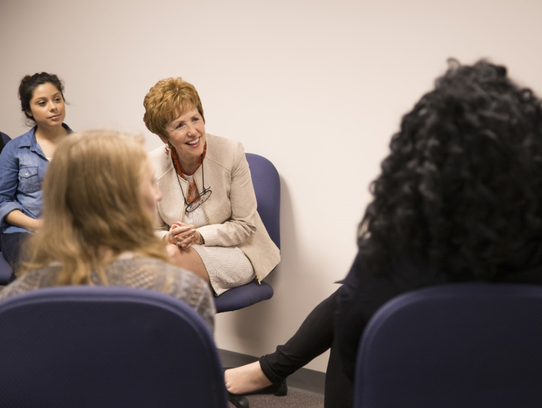 Dr. Schwalbach listens to students at Mount Mary University