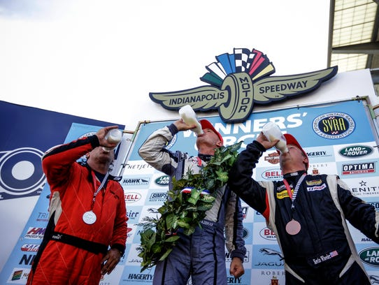 Winners of one the day's earliest races celebrate in
