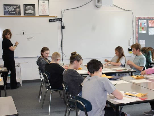 Middle school students worked to complete a composite