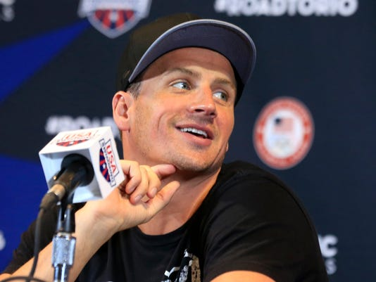 Eleven time Olympic medalist Ryan Lochte smiles during a news conference at the U.S. Olympic team trials in Omaha, Neb., Friday, June 24, 2016. (AP Photo/Orlin Wagner)