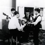 Producer George Martin, who worked with The Beatles throughout the group's career, has died at age 90. Here, he's seen in the studio with Paul McCartney (left), George Harrison and John Lennon in the early '60s.
