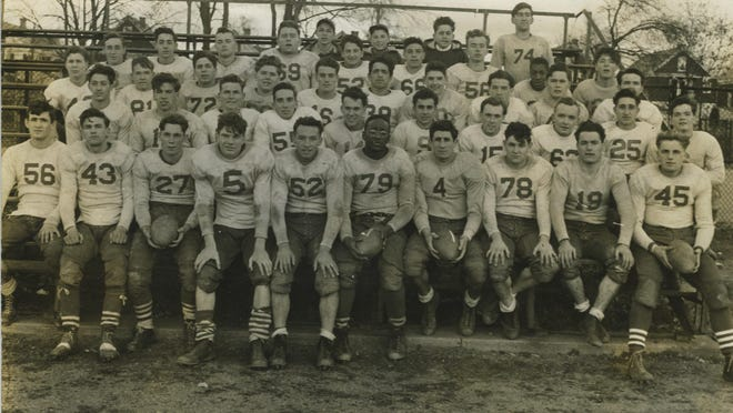 In this 1942 file photo, members of the Poughkeepsie High School varsity football team pose for a group photograph while awaiting the results of a game between two other Hudson Valley schools.