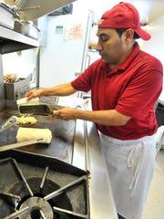 Mendez-Ramirez Manolo prepares a Swiss Burrito at Taqueria