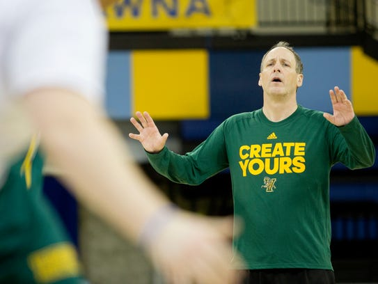 John Becker talks to his  players during Tuesday's