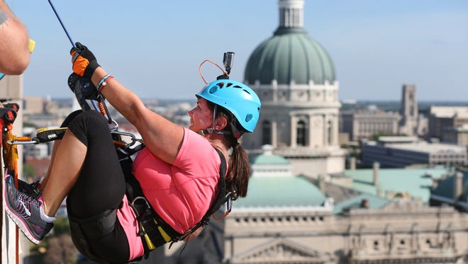 Robin Pickett, Avon, rappelled down the front of the Westin Indianapolis in 2015 to raise money for Shatterproof, an addiction-recovery nonprofit. The Juvenile Justice Ministry plans a similar fundraiser Sept. 28.