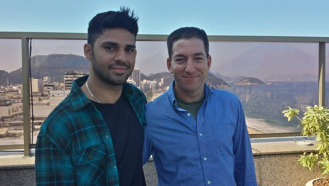 In this undated photo released by Janine Gibson of 'The Guardian,' 'Guardian' journalist Glenn Greenwald, right, and his partner David Miranda, are shown together at an unknown location.